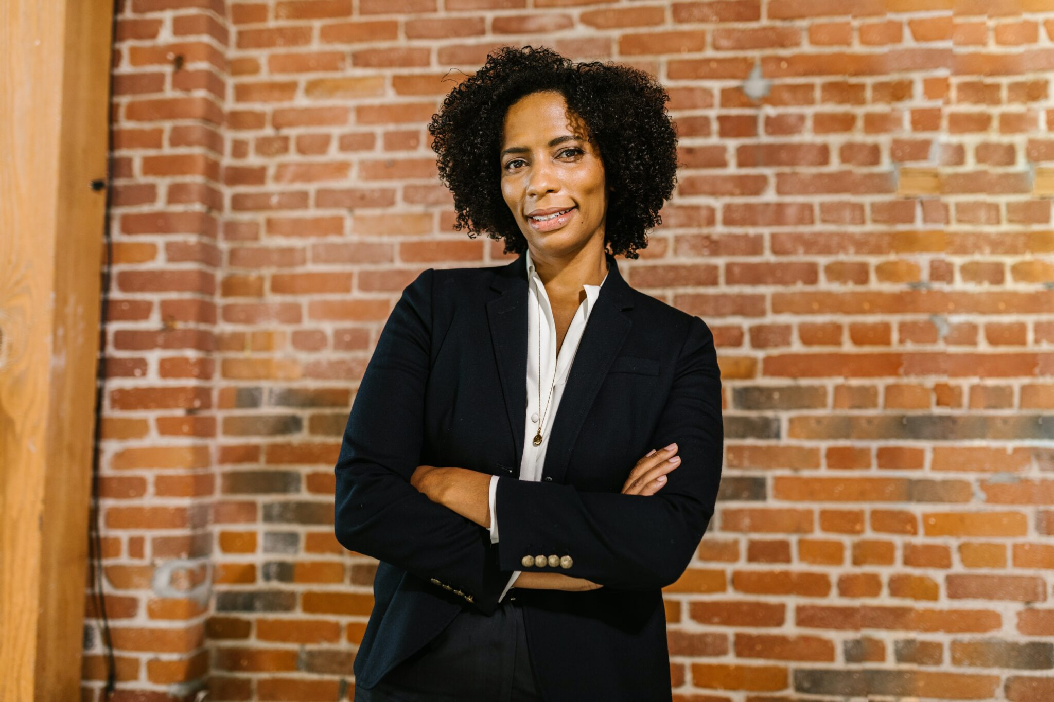 photo of a confident professional woman looking at the camera